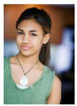 Paige Hurd in green tank and necklace